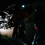 Malachi Artise (L) & Andrew Whiteford (R) discuss the meaning of life during a break while night riding.