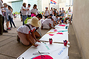 Demonstrators sign a banner against the Trump administration's policy of separating families from their children when they cross the border into the US to seek asylum. People from all over the Dallas-Fort Worth area came to make their voices heard during the Families Belong Together rally in downtown Dallas.