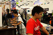 Kids playing video games at the ChinaJoy Expo, also know as the China Digital Entertainment Expo and Conference,  in Shanghai, China on 29 July, 2011. Online and social network games have become hugely popular in China as Chinese children lack the space and facility require for sports, spurning worries from parents and government officials on internet addiction.