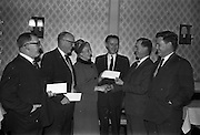 28/01/1963<br /> 01/28/1963<br /> 28 January 1963<br /> Esso National Roadside Gardens Competition Awards presented at the Anchor Hotel, Parnell Square, Dublin. Esso Petroleum Company (Ireland) Ltd. presented awards to the Dublin District winners in the Garage and Service Station Section of the competition in conjunction with Bord Failte.  Picture shows: Mr T.P. Downey, (2nd from right), Esso District Manager, presenting the awards to (from left) Mr Hugh McGuiness; Mr Michael Sheridan and Mrs Ena Goosan. Watching the presentations are Mr J.A. O'Brien, (4th from left), An Bord Failte and Mr J.H. Donovan, Director Esso.