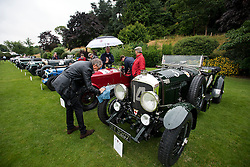 © Licensed to London News Pictures. 13/07/2015. Epsom, UK. The start of The Royal Automobile Club 1000 Mile Trial 2015 at Woodcote Park in Epsom, Surrey. The event, which starts and finishes at Woodcote Park, takes a fleet of over 40 classic cars from around the world, through a 1000 mile trial around the UK.  Photo credit: Ben Cawthra/LNP