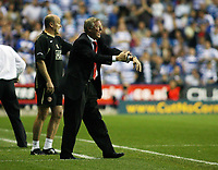 Photo: Chris Ratcliffe.<br />Reading v Manchester United. The Barclays Premiership. 23/09/2006.<br />Sir Alex Ferguson, manager of Man Utd asks how much time is added on.