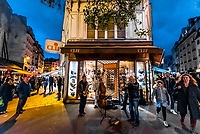 Street musicians perform on Rue du Buci, Left Bank, Paris, France.