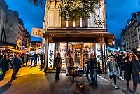 Street musicians perform on Rue du Buci, Left Bank, Paris, France.