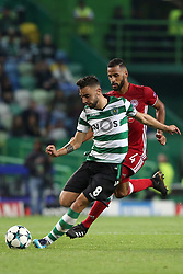 November 22, 2017 - Lisbon, Portugal - Sporting's midfielder Bruno Fernandes from Portugal (L) vies with Olympiacos' midfielder Alaixys Romao during the UEFA Champions League group D football match Sporting CP vs Olympiacos FC at Alvalade stadium in Lisbon, Portugal on November 22, 2017. Photo: Pedro Fiuza  (Credit Image: © Pedro Fiuza/NurPhoto via ZUMA Press)