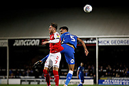 Peterborough United defender Ryan Tafazolli (5) and Fleetwood Town forward Wes Burns (7)  challenge for a header during the EFL Sky Bet League 1 match between Peterborough United and Accrington Stanley at London Road, Peterborough, England on 20 October 2018.