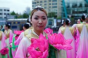 "A young woman prepared for a rehearsel for the Buddhist Lantern Parade. In Korea the birthday of Buddha is celebrated according to the Lunisolar calendar. This day is called ""Seokga tansinil"", meaning ""the day of Buddha's birthday"". The celebration is taking place for one week."