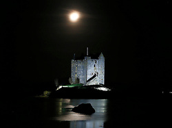 A floodlit Castle Stalker on the shores of Loch Linnhe bathed in winter moonlight. The castle is visible from the road midway between Oban and Glen Coe. The castle was also used as a  location for the filming of Monty Python and the Holy Grail...... (c) Stephen Lawson | Edinburgh Elite media