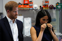 The Duke of Sussex watches as his wife, Duchess of Sussex, smells traditional native Australian ingredients during a visit to Mission Australia social enterprise restaurant Charcoal Lane in Melbourne, on the third day of the royal couple's visit to Australia.
