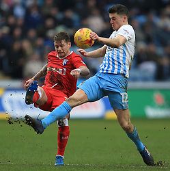 18 February 2017 - Skybet League One - Coventry City v Gillingham - Mark Byrne of Gillingham clears as Callum Reilly of Coventry City tries to intercept - Photo: Paul Roberts / Offside