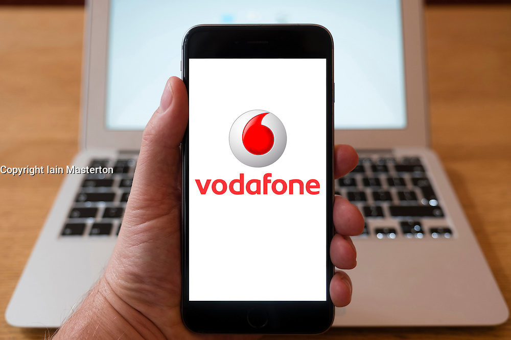 Using iPhone smartphone to display logo of Vodafone mobile phone operator