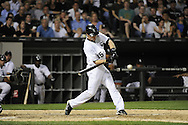 CHICAGO - JUNE 06:  Gordon Beckham #15 of the Chicago White Sox hits an RBI single in the seventh inning against the Seattle Mariners on June 6, 2011 at U.S. Cellular Field in Chicago, Illinois.  The White Sox defeated the Mariners 3-1.  (Photo by Ron Vesely)  Subject:  Gordon Beckham..