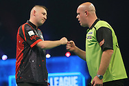 Nathan Aspinall wins his match against Michael Van Gerwen during the PDC Unibet Premier League darts at Marshall Arena, Milton Keynes, United Kingdom on 24 May 2021.
