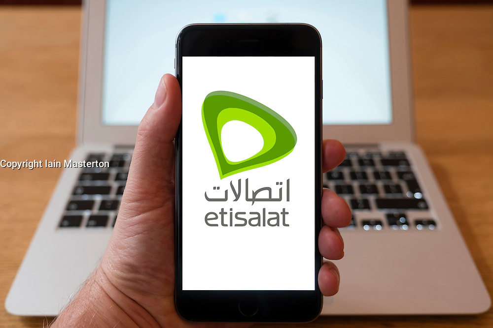 Using iPhone smartphone to display logo of Etisalat the mobile phone operator in the United Arab Emirates