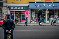 People keep a safe distance when queuing in front of the pharmacy in Milan, Italy on April 18, 2020. Daily life scenes with the new anti-COVID-19 Coronavirus prevention measures. Photo by Carlo Cozzoli/IPA/ABACAPRESS.COM