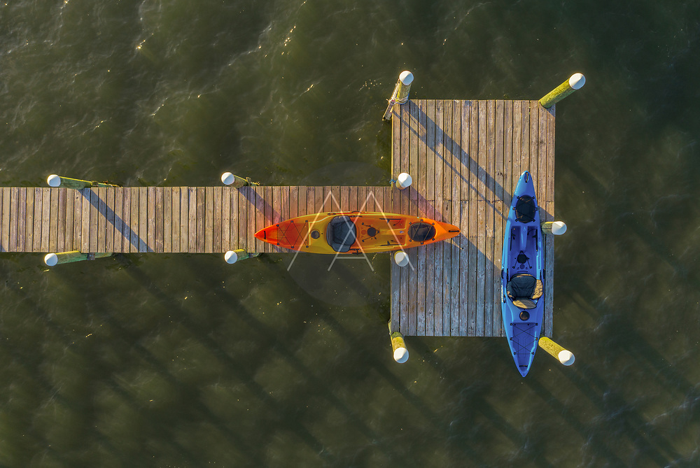 Aerial view of a few canoe standing on a wooden pier along River Lagoon, Sebastian, Florida, United States.