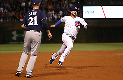 September 8, 2017 - Chicago, IL, USA - The Chicago Cubs' Kris Bryant advances to third base on a single by teammate Anthony Rizzo in the third inning past Milwaukee Brewers third baseman Travis Shaw (21) at Wrigley Field in Chicago on Friday, Sept. 8, 2017. (Credit Image: © Chris Sweda/TNS via ZUMA Wire)