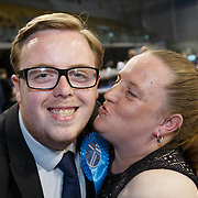 Thomas Kerr (20) wins Shettleston for the Conservatives. Gets a kiss from his mum Deborah. Scottish Local Government Elections 2017 at the Emirates Arena, Glasgow. Picture Robert Perry  2017<br /> <br /> Must credit photo to Robert Perry<br /> FEE PAYABLE FOR REPRO USE<br /> FEE PAYABLE FOR ALL INTERNET USE<br /> www.robertperry.co.uk<br /> NB -This image is not to be distributed without the prior consent of the copyright holder.<br /> in using this image you agree to abide by terms and conditions as stated in this caption.<br /> All monies payable to Robert Perry<br /> <br /> (PLEASE DO NOT REMOVE THIS CAPTION)<br /> This image is intended for Editorial use (e.g. news). Any commercial or promotional use requires additional clearance. <br /> Copyright 2014 All rights protected.<br /> first use only<br /> contact details<br /> Robert Perry     <br /> 07702 631 477<br /> robertperryphotos@gmail.com<br /> no internet usage without prior consent.         <br /> Robert Perry reserves the right to pursue unauthorised use of this image . If you violate my intellectual property you may be liable for  damages, loss of income, and profits you derive from the use of this image.