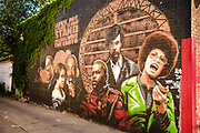 """15 AUGUST 2020 - MINNEAPOLIS, MINNESOTA: A mural honoring historic Black figures near the George Floyd Memorial in Minneapolis. Floyd, an unarmed Black man, was killed by Minneapolis police officers of May 25 in front of Cup Foods, a convenience store at the intersection of 38th and Chicago Ave. His killing sparked a week of violent protests across the country. The intersection where he was killed is still closed and has become an unofficial memorial visited by hundreds of people every day. Saturday, more than 100 people gathered at the memorial to demand the city preserve the memorial. The city of Minneapolis had planned to start reopening the intersection as soon as Monday Aug. 17, but delayed those plans indefinitely on Friday, Aug. 14. City residents have created a """"George Floyd Zone"""" at the intersection. They're demanding the recall of Hennepin County Attorney Mike Freeman, requiring Minneapolis police officers have their own private liability insurance, and the allocation of funds for businesses and residents in the community. The city is considering officially renaming Chicago Ave. between 37th and 39th """"George Floyd Jr. Place.""""     PHOTO BY JACK KURTZ"""