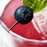 detail of a blueberry basil margarita craft cocktail