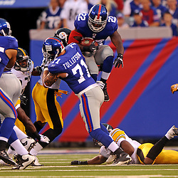 21 Aug, 2010: New York Giants running back Andre Brown (22) leaps over Pittsburgh defenders on a kick off return during first half NFL preseason action between the New York Giants and Pittsburgh Steelers at New Meadowlands Stadium in East Rutherford, New Jersey.