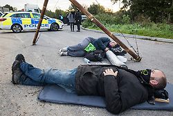 Anti-HS2 activists use a lock-on arm tube to block one of several entrances blocked to the Chiltern Tunnel South Portal site for the HS2 high-speed rail link on 9 October 2020 in West Hyde, United Kingdom. The protest action, at the site from which HS2 Ltd intends to drill a 10-mile tunnel through the Chilterns, was intended to remind Prime Minister Boris Johnson that he committed to remove deforestation from supply chains and to provide legal protection for 30% of UK land for biodiversity by 2030 at the first UN Summit on Biodiversity on 30th September.