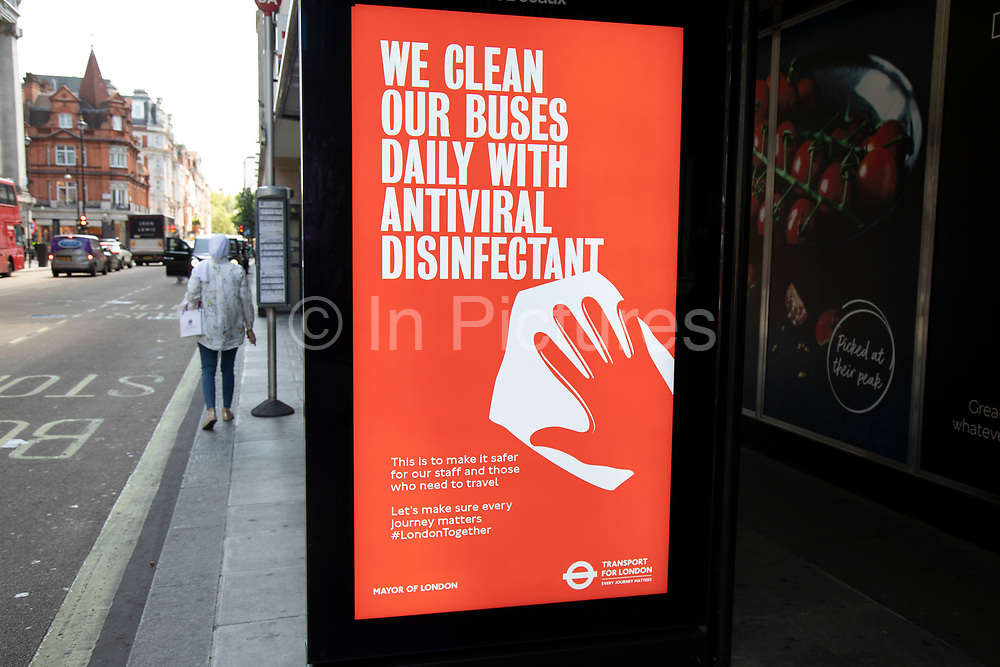 HM Government, Public Health England, Transport for London  advertising boards advice as the Coronavirus lockdown measures are set to ease further, the west end starts to fill with people as they return to the shopping district on Oxford Street and the quiet city starts coming to an end on 22nd June 2020 in London, England, United Kingdom. As of today the government has relaxed its lockdown rules, and is allowing some non-essential shops to open with individual shops setting up social distancing queueing systems.