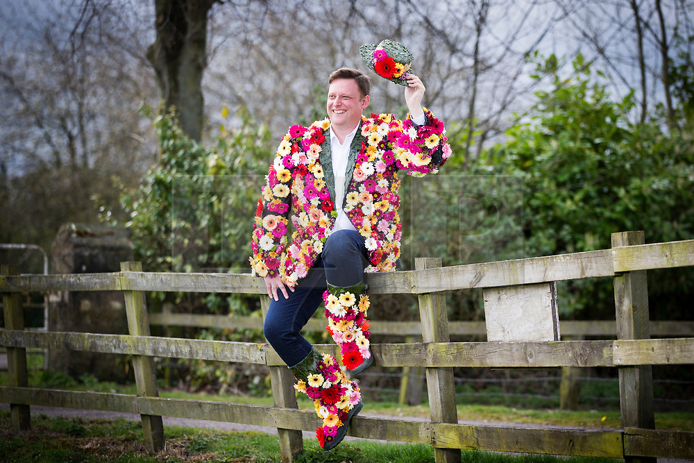 © Licensed to London News Pictures. 04/04/2017. Harrogate UK. North of England Horticultural Society director Nick Smith dons his coat of many flowers to launch national Wear a Flower Day in Harrogate today. National Wear a Flower day is being introduced on 20th April, the first day of the Harrogate Flower Show by the North of England Horticultural Society organisers of the Harrogate Flower Show, with the aim of persuading people to choose a favourite bloom and wear it for the day in celebration, in commemoration or simply to make someone smile.Photo credit: Andrew McCaren/LNP