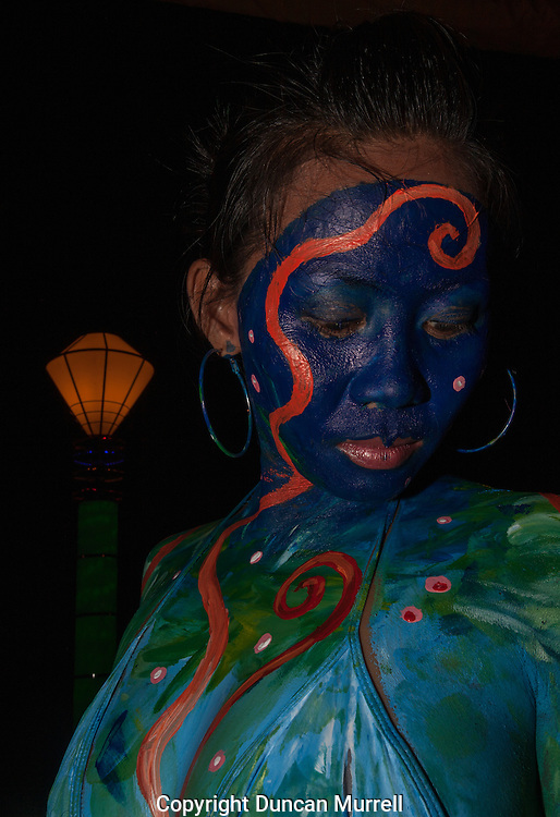 Body painting competition during the Balayong Festival at Baywalk, Puerto Princesa, Palawan, the Philippines.