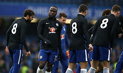"""Chelsea's Victor Moses (centre) and his team-mateS wearing the shirt number """"8"""" on their pre-match training shirts in memory of the late Ray Wilkins"""