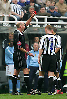 Photo. Andrew Unwin, Digitalsport<br /> Newcastle United v Aston Villa, Barclays Premiership, St James' Park, Newcastle upon Tyne 02/04/2005.<br /> Newcastle's Kieron Dyer (R) is sent off by the referee, Barry Knight (L), for fighting with Lee Bowyer