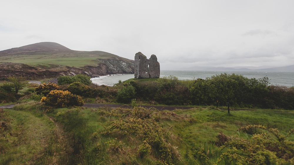 The rugged coastal landscape at Menard Castle in Ireland.