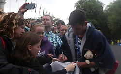 Team Great Britain's Jonathan Brownlee signs autographs after the 2018 Accenture World Triathlon Mixed Relay Event in Nottingham.