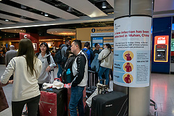 © Licensed to London News Pictures. 24/01/2020. London, UK. Signs have been installed around Heathrow Terminal 4, warning passengers of the symptoms of the new Wuhan coronavirus outbreak. The coronavirus virus has infected more than 800 people across Asia in the past few weeks Photo credit: Alex Lentati/LNP