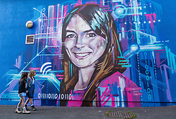 Edinburgh Science Festival, Edinburgh, Scotland, United Kingdom: <br /> Pictured: Valentina Maia, aged 6 years, and Edie Lamont, aged 7 years, admire the portrait by graffiti and mural artist Shona Hardie of  Natalie Duffield, one of the artworks in a street art trail called 'Women in STEM' which showcases the achievements of nine women who have contributed to the world of Science, Technology, Engineering and Maths (STEM). Natalie Duffield is CEO of InTechnology SmartCitie, a company that provides free WiFi in central Edinburgh. Shona has also painted many of the other portraits in the trail which are displayed in venues across the city. <br /> The 2021 Edinburgh Science Festival runs from 26 June – 11 July.<br /> Sally Anderson | EdinburghElitemedia.co.uk