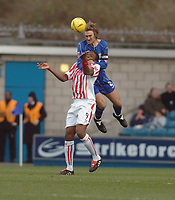 Photo. Leigh Quinnell.  Millwall v Stoke City Coca Cola championship. 19/02/2005. Millwall captainMatt Lawrence out jumps Stokes Gifton Noel-Williams
