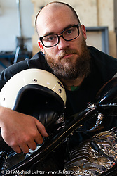 Andy Carter checks out a Beetle Helmet from Japan at Jeff Leighton and Dave Polgreen's The Wretched Hive shop just before the start of the Born Free 9 Motorcycle Show. Santa Ana, CA. USA. Wednesday June 21, 2017. Photography ©2017 Michael Lichter.