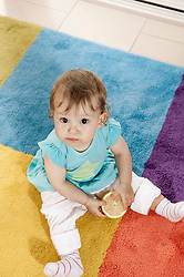 From above portrait baby girl sitting carpet