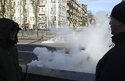 November 18, 2018 - Kiev, Ukraine - Policemen look at the smoke bomb thrown towards the rally of people rallying for transgender's rights in Kyiv, Ukraine, November 18, 2018.  International day for the remembrance of transgender people is held around the world on November 18. (Credit Image: © Sergii Kharchenko/NurPhoto via ZUMA Press)