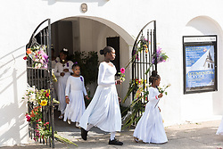 June 17, 2017 - Charleston, SC, United States - Young members of the praise dance group of the Mother Emanuel African Methodist Episcopal Church walk out of the church during a ceremony marking the 2nd anniversary of the mass shooting June 17, 2017 in Charleston, South Carolina. Nine members of the historic African-American church were gunned down by a white supremacist during bible study on June 17, 2015. (Credit Image: © Richard Ellis via ZUMA Wire)