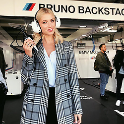 """Lena Gercke releases a photo on Instagram with the following caption: """"Giving some last instructions for the @bmwm team!!! Good luck for the Race later! Fingers crossed \u270c\ud83c\udffb #bmwm #challengeus"""". Photo Credit: Instagram *** No USA Distribution *** For Editorial Use Only *** Not to be Published in Books or Photo Books ***  Please note: Fees charged by the agency are for the agency's services only, and do not, nor are they intended to, convey to the user any ownership of Copyright or License in the material. The agency does not claim any ownership including but not limited to Copyright or License in the attached material. By publishing this material you expressly agree to indemnify and to hold the agency and its directors, shareholders and employees harmless from any loss, claims, damages, demands, expenses (including legal fees), or any causes of action or allegation against the agency arising out of or connected in any way with publication of the material."""