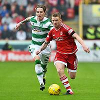 12/09/15 LADBROKES PREMIERSHIP<br /> ABERDEEN v CELTIC <br /> PITTODRIE - ABERDEEN<br /> Celtic's Stefan Johansen (left) closes down Jonny Hayes