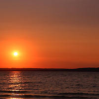 """""""Grand Traverse Bay in Gold""""<br /> <br /> Scenic orange and gold sunset over Grand Traverse Bay in Michigan!!<br /> <br /> Sunset Images by Rachel Cohen"""