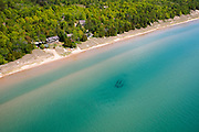 A sunken ship's carcass sits in the waters of Lake Michigan, off of the southern coast of Door County, Wisconsin, near Whitefish Dunes State Park.