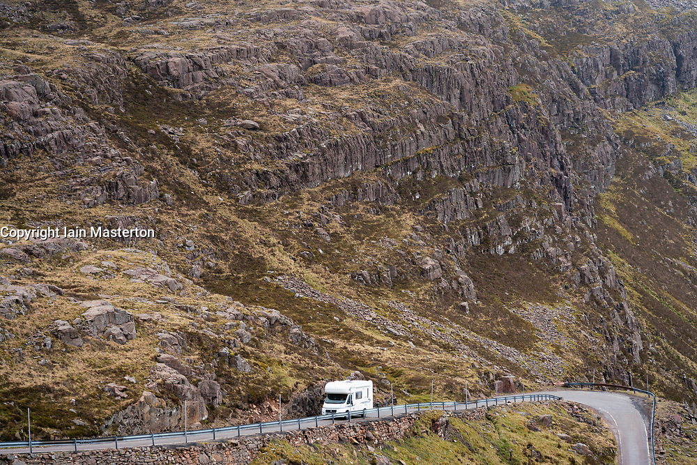 View of single track road with motorhome on Bealach na Ba pass on Applecross Peninsula  the North Coast 500 driving route in northern Scotland, UK