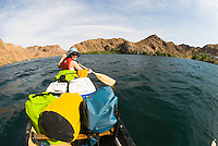Canoer makes a splash while on a trip through The Black Canyon, Nevada.