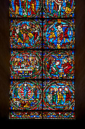 Medieval stained glass Window of the Gothic Cathedral of Chartres, France - dedicated to the Passion.  A UNESCO World Heritage Site..