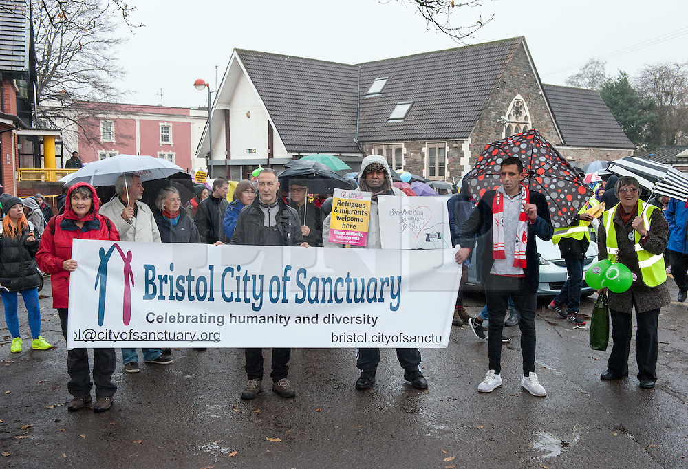 """© Licensed to London News Pictures. 10/12/2016. Bristol, UK. Bristol is asked to Embrace Diversity on International Human Rights Day, welcoming humanity and diversity and building stronger communities to resist racism in Bristol as the focus of key events commemorating International Human Rights Day on Saturday 10th December 2016. There was a Sanctuary Walk from the Malcolm X Community Centre in St Pauls, headed by representatives of all Bristol's civic leaders, through the city centre to Bristol Cathedral. The two part event was organised by Bristol City of Sanctuary and local charity Bristol Refugee Rights. Revd Richard McKay, Chair of Bristol City of Sanctuary says, """"This walk will send out a clear message that Bristol is a City of Sanctuary and that we welcome refugees and asylum seekers in our beautiful city. We are walking to show welcome to those seeking sanctuary in our city. We are walking to join with other proud Bristolians to say that we are a city of diversity that treasures human rights."""" Photo credit : Simon Chapman/LNP"""