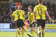 Burton Albion defender Kyle McFadzean (5) scores a goal from a direct free kick and celebrates 2-2 during the EFL Sky Bet League 1 match between Burton Albion and Accrington Stanley at the Pirelli Stadium, Burton upon Trent, England on 23 March 2019.