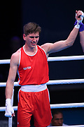Gedminas Mindaugas of Norway (red) celebrates beating Imre Balazs Bacskai of Hungary (not pictured) in the Men's Middleweight preliminaries during The Road to Tokyo European Olympic Boxing Qualification, Sunday, March 15, 2020, in London, United Kingdom. (Mitchell Gunn-ESPA-Images/Image of Sport)